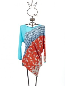 Fly away bird dance on this asymmetrical mixed media tunic.